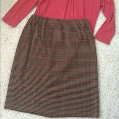 """Brown  Plaid Skirt This plaid skirt is great dressed up or down. Anything from a blouse, jacket and heels to a chunky sweater, boots and tights works well. Great with leather or suede 64% polyester; 33% rayon; 3% spandex. Dry clean  Waist 14.5 """" lying flat; hip 19"""", stretches to about 22""""; length 20.5"""". Back hidden zipper Like new condition - only worn a few times Smoke free home. Amanda Smith Skirts"""