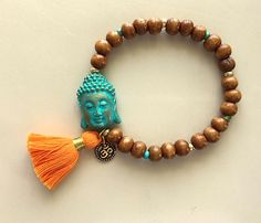 Buddha Om and Tassel Brown Wooden Bead Adjustable Bracelet by MagicalUniverse on Etsy