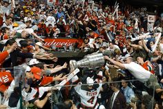 New Jersey Devils captain Scott Stevens carries the Stanley Cup off the ice after beating the Mighty Ducks of Anaheim in Game 7 in East Rutherford, N. Captain Scott, East Rutherford, Stanley Cup Finals, New Jersey Devils, Sports Art, Sports Illustrated, Ice Hockey, Nhl, Cool Photos