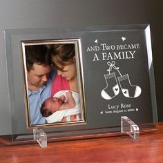 "Became a Family New Baby Beveled Glass Picture Frames. Give this precious, Engraved New Baby Picture Frame to yourself or the proud new parents and create a personalized treasured gift for a lifetime. Our Engraved New Baby Picture Frame is a heavy-weight glass with beveled edges on all sides, accented with golden brass frame trim. Engraved New Baby Frame measures 8"" x 11"" and holds your 4"" x 6"" photo; includes clear easel legs for top"