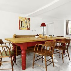 White dining room with red farmhouse table