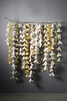 Floral handmade paper decorations would be so pretty for a photobooth backdrop.