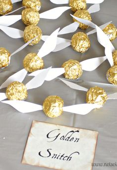 Gold-wrapped candy and some paper wings make the perfect Golden Snitch Snack. #HarryPotter