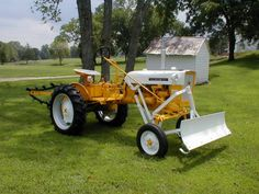 "rollerman1: ""Later model IH Cub with the optional dozer blade & trencher attachments. """