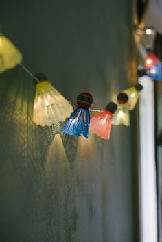 DIY: shuttlecock lights garland. Start with mini Christmas lights available in a wide array of colors and lengths at http://www.partylights.com/Mini-Lights