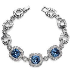 "Stunning bracelet made of rhodium plated metal. The Stars of the bracelet are 3 sparking Denim blue Swarovski Crystal that measure approx. .5"" by .5"" and are surrounded by a double layer of shimmering smaller Crystals."