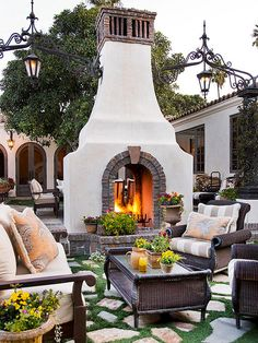 This unique outdoor fireplace adds such character to a patio space