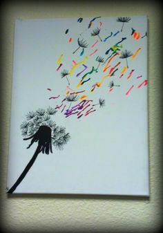 Splatter from my crayon melting art blowing away with the dandelion seeds.