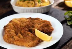 Wiener Schnitzel - veal cutlets pounded really thin, breaded and fried until tender and crispy. Wiener Schnitzel is traditionally served with lemon and potat. Wiener Schnitzel, Entree Recipes, Cooking Recipes, Veal Cutlet, Frying Oil, Chicken Bites, Chicken Cutlets, Sliced Potatoes, Greek Recipes