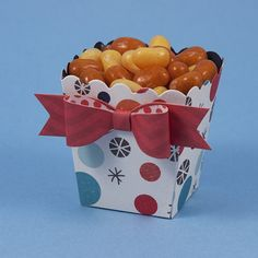 This is the perfect example of a box that is just too cute to throw away. Make a little May Day treat for everyone you know this year.