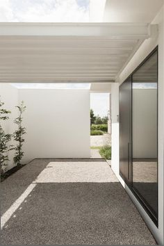 On a narrow plot in Belgium sits the lovely minimalist dwelling called House DZ. Designed by Belgian architecture firm Graux & Baeyens, House DZ a. Architecture Design, Agi Architects, Porch Kits, Building A Porch, Interior Minimalista, Home Improvement Loans, House With Porch, Patio Roof, Land Scape