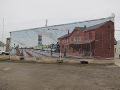 Calmar, Iowa--Historic railroad mural at edge of tracks there still used. [February 2012)