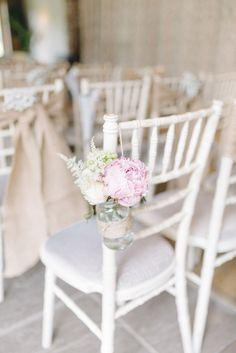 Chair Decor | Jars filled with Peonies | Sarah Jane Ethan Photography | http://www.rockmywedding.co.uk/charlotte-kevin/
