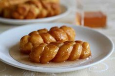Koeksisters are small crispy donuts that are popular in South Africa. They are braided and fried, then soaked in a fragrant sugar syrup. South African Recipes, Sweet 16, Donuts, Sausage, Fries, Traditional, Baking, Syrup, Cupcakes