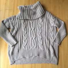 Light purple/gray oversized sweater SO COMFORTABLE! Loose fitting beautiful sweater! Pretty color with a little bit of glimmer! Jennifer Lopez Sweaters Cowl & Turtlenecks