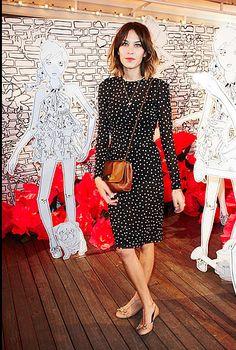 Alexa. Simply chic. Love the tan bag worn with black dress.