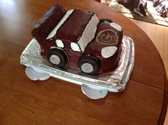 3D Car Cake for G's birthday. Three 9x13 sheet cakes stacked. Carve top and windshield. Use excess to make spoiler (secure with toothpicks). Wheels are Entennmen's chocolate-frosted donuts, holes filled with frosting and dipped in silver sprinkles for hubcaps. Recipe is Ina Garten's Beatty's chocolate cake.