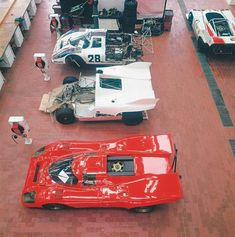 """In Weissach's shops, an intriguing lineup of 917s awaited attention. From bottom: the 917K """"Weissach taxi,"""" a coupe specially prepared to offer VIP visitors a thrilling lap of the test track; an early spyder prototype; the 1971 917K coupe for Le Mans; and, upper right, one of the 917/10 Can-Am cars. Porsche Archive"""