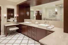Whether contemporary or traditional, top designers transform bathrooms with creative tile displays, sleek fixtures and colorful palettes.