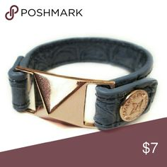 BCB Generation Pyramid Stud Bracelet - Rose Gold Brand new! Never before worn BCB Generation Bracelet in Blue with Rose Gold Pyramid Stud. Bracelet snaps on under circle stud. Please note, original retail tags are no longer attached to this item. BCBGeneration Jewelry Bracelets