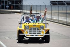 A Mini Moke transfers the Queen's Baton from Townsville Airport to the start of the baton relay along The Strand in Townsville, Australia on...