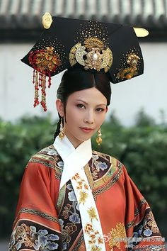 Chinese cultural dress. I believe it's in the style of the Qing dynasty.
