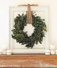 Simple holiday decor greenery wreath hanging in an empty frame   Design Ideas Using Empty Frames