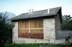 ** contrasting materials; interesting opening/'window'; concrete meets stone;   The Rustic Refinement Of Renovated Barns - Architizer