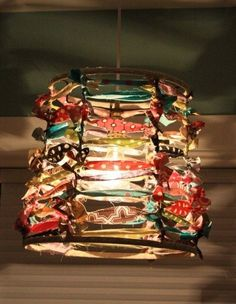 Fabric Strand Lampshade: Take fabric and pin it onto the bare bones of a lampshade to make a cute fabric lamp. With more fabric pieces, it would be a cute craft room or kids lamp.