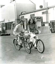Katharine Hepburn and Katharine Houghton ride bikes.
