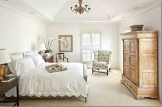 Bowood linen which covers the chair and the French headboard!