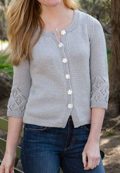 Free Knitting Pattern for Touch of Lace Cardi - This classic stockinette sweater features lacy detailing on the three-quarter length sleeves. Designed by Melissa Leapman for Red Heart. Women's S (M, L, 1X, 2X)