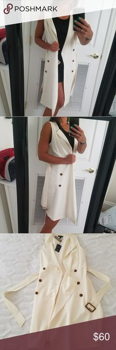 """J. CREW Sleeveless Trench Jacket NWT! Beautiful sleeveless trench jacket or cardigan. J. CREW brand, ivory white colored with brown buttons. Falls to below knee-length (I'm 5'5""""). Wear open as layer piece as shown or closed as dress with heels! Detachable belt. Perfect for dressy or casual occassions for refined look! Minor blemishes on belt as seen in photos. Price reflects this. NWT and flawless otherwise! Size tag is 6 but i believe would fit 2/4/6 (i am size 2). Love this but needs a new…"""