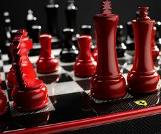 The Ferrari carbon fiber chess set is the ultimate game board for the sports car aficionado who's got it all – except the expensive car. Each piece is crafted from carbon fiber covered wood and features an attractive enameled metal Ferrari shield on the front.