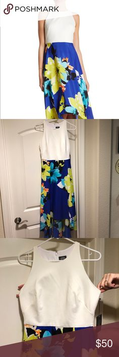 NWT Vince Camuto High Low Dress Racer Back Size 8 This dress is absolutely gorgeous and has a great flowing skirt that is partially lined. The zipper up the back makes a snug fit in the chest. It's very flattering on. Vince Camuto Dresses High Low