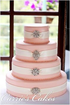 Pink with ribbon cake | Quinceanera cake Ideas |  http://www.quinceanera.com/quinceanera-cakes/?utm_source=pinterest&utm_medium=social&utm_campaign=category-quinceanera-cakes