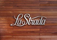 pretty script; love the smooth contrasted against the wood.