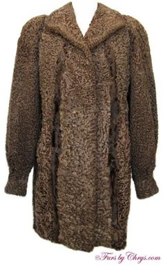Brown Astrakhan Karakul Lamb Stroller Coat #KL727; $495.00 (sale!); Excellent Condition; Misses 10 - 14. This is a stunning genuine natural brown astrakhan karakul lamb fur coat in the versatile stroller length. Purchased in Russia, it has a Brigantina Trade Mark label and features a wing-style collar, bracelet cuffs and built-in shoulder pads. Lamb is a very warm fur, and this is a superior astrakhan karakul lamb coat which has very soft, curly fur with a beautiful sheen. fursbychrys.com
