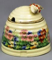 """A Clarice Cliff pottery """"Beehive"""" pattern honey pot and cover, printed in colours with flowers"""
