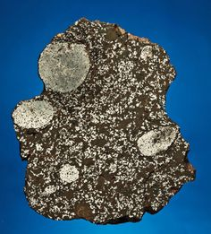This is a mesosiderite meteorite.  It is a stony-iron type and it consists of nearly equal parts of metal and silicates.  This specimen has been cut to reveal the interior.  On the outside, this meteorite would look like many others.  Only when it is cut, is the true nature revealed.