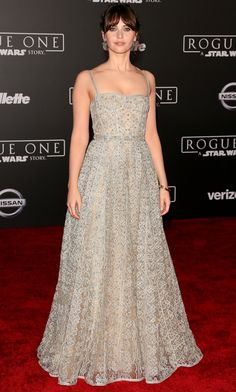 FELICITY JONES in an embroidered floor-length corset gown by Dior with fine jewelry by the brand at the premiere of Rogue One: A Star Wars Story in Hollywood.