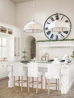 Linen-covered pendant lamps help cozy up the 17-foot ceilings in this kitchen. #decoratingideas