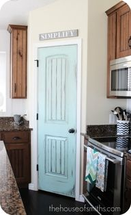Distressed Pantry Door. LOVE IT! I have to do this for my pantry.