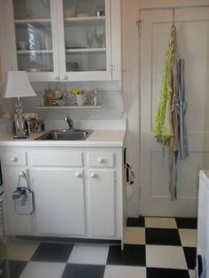 black & white checker floor. adorable in a small kitchen space.