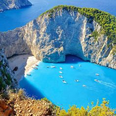 On the island of #Zakynthos you'll find Navagio Beach — also known as Shipwreck Beach or Smugglers Cove, in reference to its often colorful past. Bounded on either side by steep cliffs, the beach offers crystalline waters and perfect white sands. There are no roads in, so book a boat tour on TripAdvisor and head for Navagio Beach!