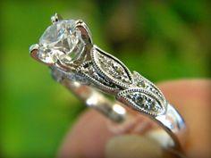 Kirk Kara engagement ring with diamonds set in white gold. Botanical or filigree antique design.