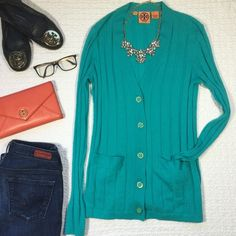 Tory Burch Cashmere Cardigan Sweater Gorgeous turquoise cardi, super soft (100% cashmere). Two front pockets, long sleeves and wonderful gold buttons with enamel color & TB lettering. Does have two small holes, one on the left sleeve (which can be easily covered by cuffing) and another on the left bottom side close to the seam. Other than that, in excellent condition :) Tory Burch Sweaters Cardigans