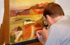 A Midwest Art Conservation Center paintings conservator at work