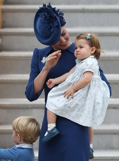 But all eyes were on Princess Charlotte, 16 months, making only her third public appearance as she clung to her mother, Kate