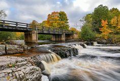 Big Eric's Bridge over the pristine Huron River in Upper Michigan. Michigan Waterfalls, Old Bridges, Waterfall Photo, Mackinac Bridge, Over The Bridge, Water Sources, Unique Architecture, Covered Bridges, Fall Photos